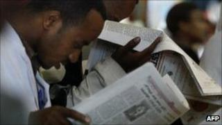 People reading newspapers in Ethiopia (Archive shot 2005)
