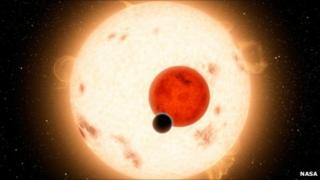 An artist's conception of Kepler-16b, which orbits two stars