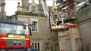 Builder transported down from scaffold