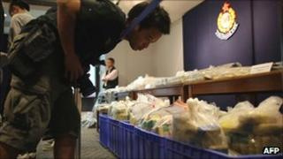 Photographer looks at cocaine haul on display at a Hong Kong police station on 18 September 2011