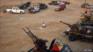 Anti-Gaddafi fighter prays near Sirte - 18 September