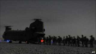 US and Afghan security forces board a Chinook helicopter in Kandahar province southern Afghanistan - 14 August 2011