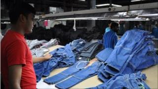 Pile of completed jeans in a Bangladeshi clothes factory