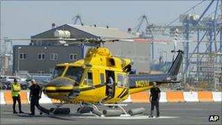 Helicopter ferrying workers to a Noble offshore oil and gas rig prepares to take off from Cyprus's Limassol port on 19 September 2011