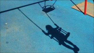 Shadow of a child on a park swing
