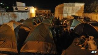 People spend the night outside in tents in Cuilapa