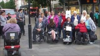 Disabled protesters in Worcester city centre