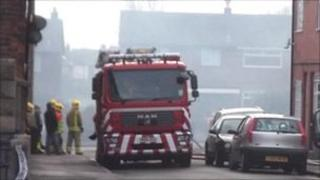Fire engine and firefighters