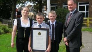Jolene Gill (Rhys's mother), Rhys, Jordan Carthy (Rhys's brother), and Det Con Nick Busby from the Major Crime Unit.