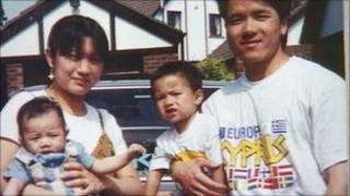 Simon Tang with his wife and two sons