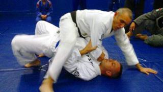 Scott McVeigh with an opponent