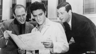 Elvis Presley (C) at MGM studios in Culver City, California in 1957