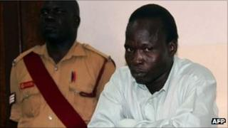 Thomas Kwoyelo (right) appears before the International Crimes Division court in the northern town of Gulu in July 2011