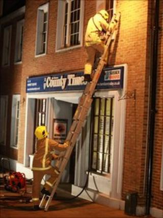 Firefighters at the offices of the West Sussex County Times
