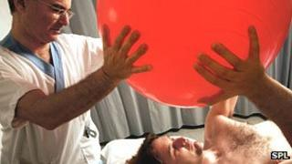 Patient doing exercises with a Swiss ball