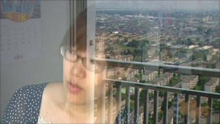 Emiko Yamamoto looks out from the 30th floor