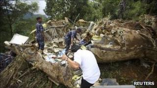Police inspect the crash site in Lalitpur, Nepal (25 Sept 2011)