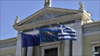 EU, National Bank and Greek flags in front of the National Bank of Greece