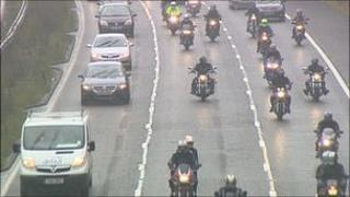Motorcylists perform a 'go slow' on the M6 in Staffordshire