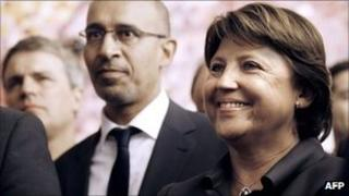 French Socialist politicians Martine Aubry (R) and Harlem Desir (L) listening to a Socialist victory speech in the Senate
