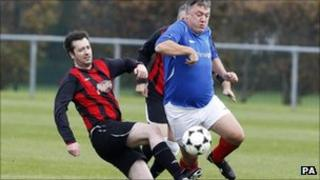 Ed Balls playing football with journalists