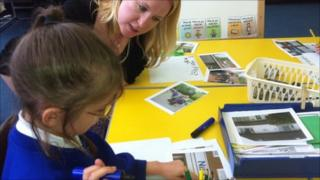 Teacher working with a pupil at Baguley Hall Primary School