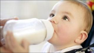 Baby with bottle (generic image)