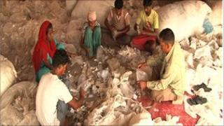 People sorting plastic bags