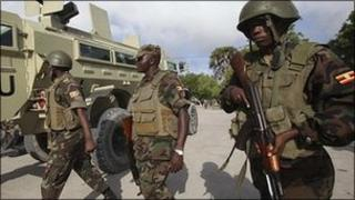 "Ugandan peacekeepers from the African Union Mission in Somalia patrol Somalia""s capital Mogadishu, 20 August 2011"