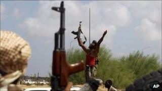 An anti-Gaddafi fighter cheers as he arrives in Sirte, on 27 September
