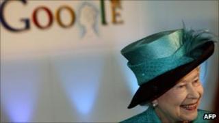 The Queen in front of Google logo
