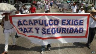 Teachers in Acapulco march on 14 September, with banner saying: Acapulco demands peace and security