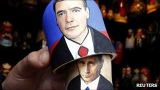 Traditional Matryoshka doll bearing the faces of Russian Prime Minister Vladimir Putin (underneath) and President Dmitry Medvedev