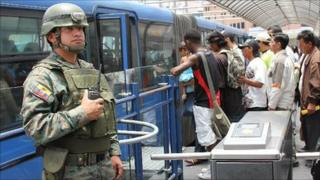 Soldier stands guard at turnstile at La Marin bus station