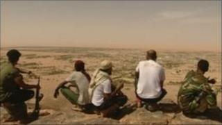NTC fighters look for Colonel Gaddafi in the desert
