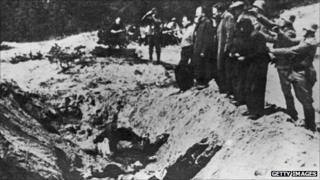 1941. Nazi commanders line up Jews to shoot them and push them into the Babi Yar ravine.
