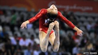 Sui Lu performs on the balance beam in the artistic gymnatics at the 16th Asian Games in Guangzhou