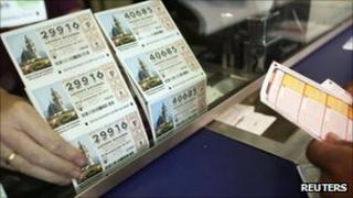 Man buys lottery ticket