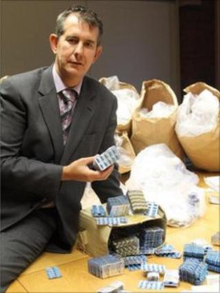 Health Minister Edwin Poots with seized drugs