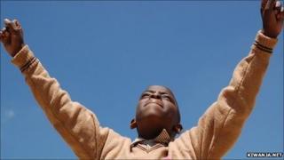 African boy cheering