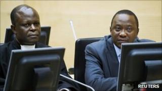 Uhuru Kenyatta (R)attends a hearing at the International Criminal Court (ICC) in The Hague on 21 Sept