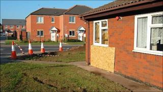 Bungalow boarded up after a police car crashed into it in Mansfield Woodhouse