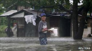 Resident carries food in Calumpit north of Manila - 1 October