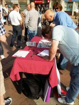 People signing a petition in Hull's Queen Victoria Square