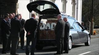 Mourners at the funeral of Garry Jenkins in Lower Cwmtwrch.