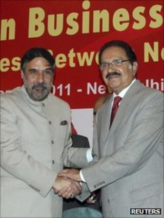 India's Trade Minister Anand Sharma and his Pakistan counterpart Makhdoom Amin Fahim (right) shake hands