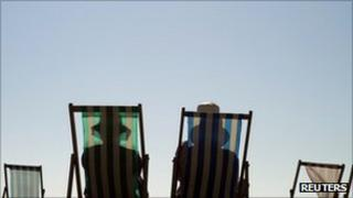 Sunbathers on deck chairs - generic