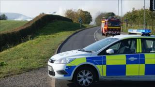 Police close the A525 in Wrexham as smoke crosses the road