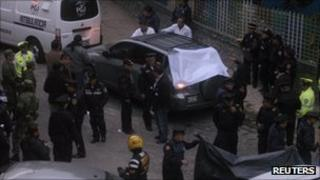 Police and forensic teams in Mexico City on 3 October 2011