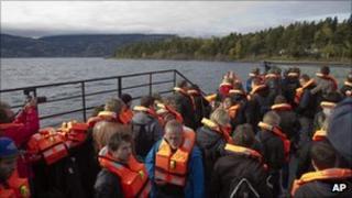 Journalists aboard on a ferry to Utoeya island 3 October